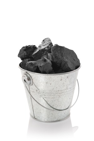 The zinked bucket with coal on a white background Stock Photo