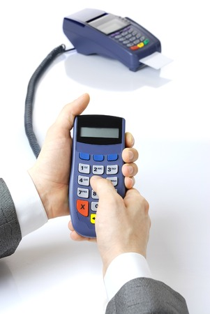 Pinpad and terminal with a card. Pinpad in hands at the businessman. photo