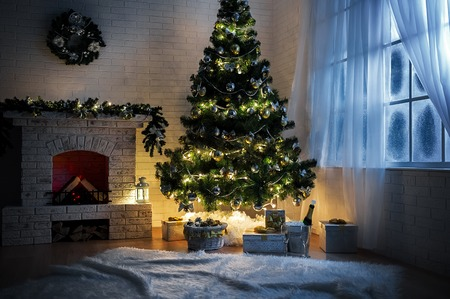 christmas fireplace: Evening interior with elegant Christmas tree and fireplace Stock Photo