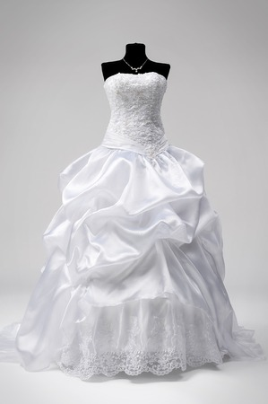 Beautiful snow-white bridal dress on a mannequin