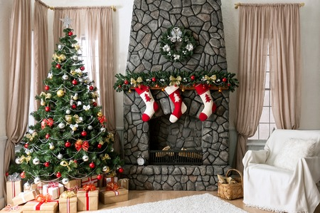 stone fireplace: Christmas interior with natural light, Christmas tree and fireplace