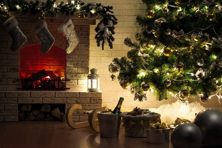 Evening interior with elegant Christmas tree and fireplace Stock Photo
