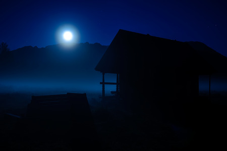 Lonely house on a moonlit summer night