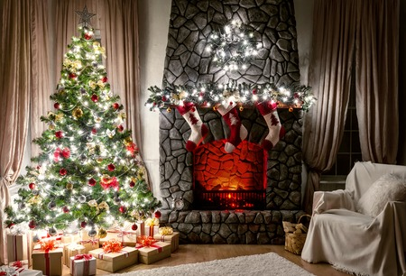 Christmas evening interior decorated with Christmas tree and fireplace photo