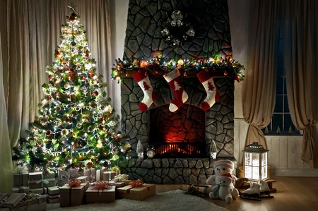 stone fireplace: Christmas evening interior decorated with Christmas tree and fireplace