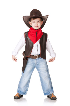 The little boy in a suit of the cowboy on a white  Stock Photo