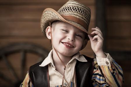 Portrait of a boy in a cowboy decor Imagens