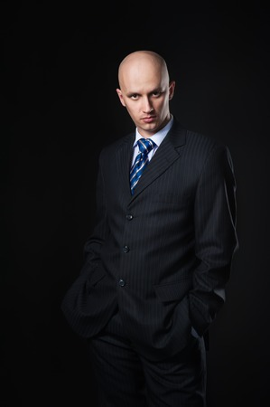 bald man: The businessman on a black  Stock Photo