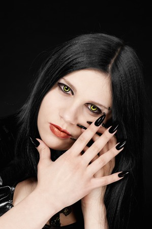Girl in the Gothic style, on a black background Stock Photo