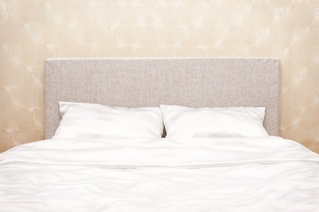 bedclothes: Bed with white bed-clothes