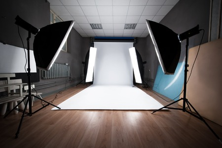 lighting background: Interior and the equipment of a photographic studio ready for realization of photosession. Stock Photo