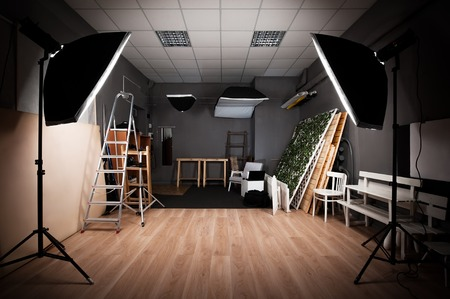 Interior and the equipment of a photographic studio ready for realization of photosession. Banco de Imagens