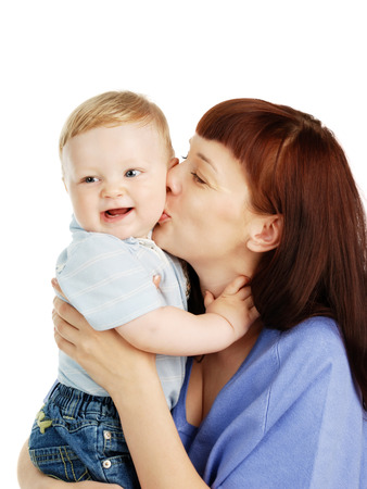Mum kisses the smiling child photo