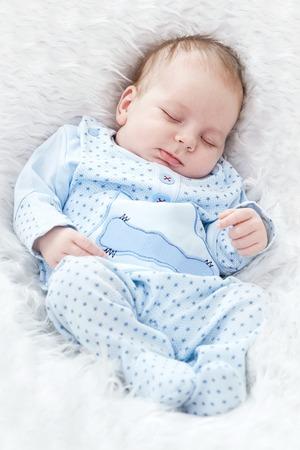 Beautiful sleeping baby on fur