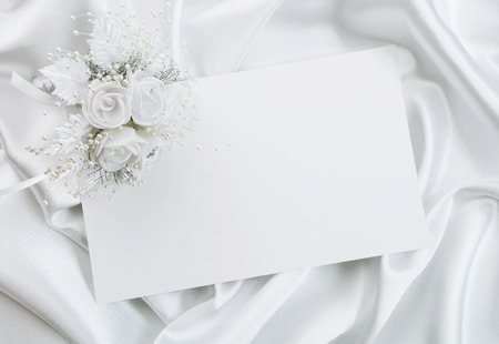 The wedding invitation with a bouquet of the bride on a white background Stock Photo