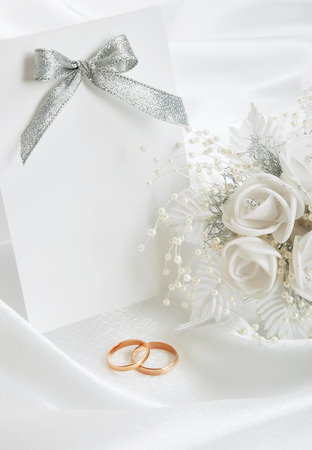 The wedding invitation with wedding rings on a white background the wedding invitation with wedding rings and a bouquet of the bride on a white background junglespirit Gallery