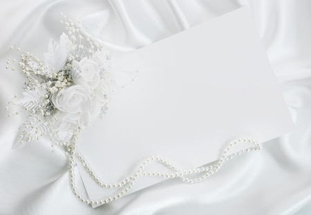 The wedding invitation with a bouquet of the bride on a white background Banco de Imagens
