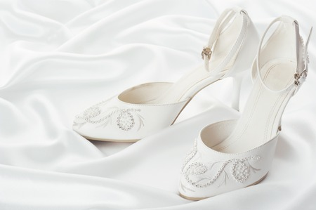 heel strap: White shoes of the bride on a white background Stock Photo