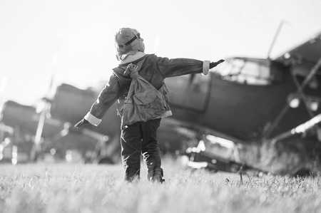 Young Aviator parked aircraft at the airport autumn day Zdjęcie Seryjne