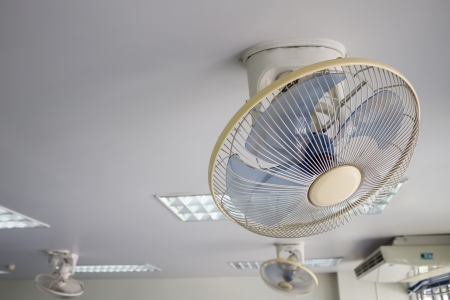 electric fan on white ceiling