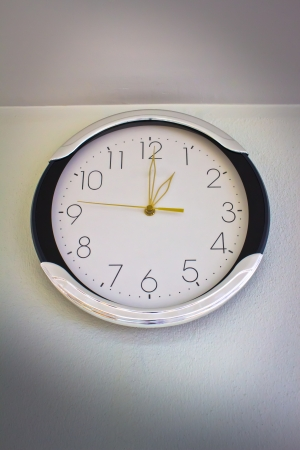 The clock on white wall photo