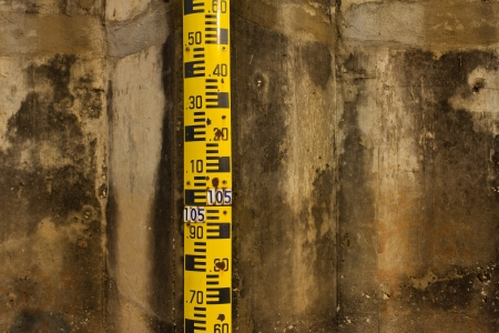 depth measurement: water level in the dam Stock Photo