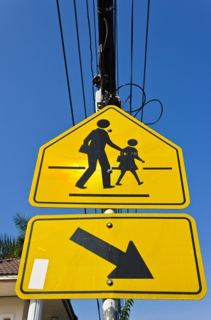 yellow signpost beware the children photo
