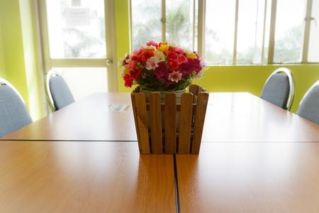 beautiful flower in meeting room photo