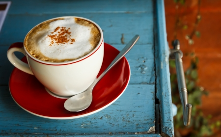 morning coffee: a cup of coffee on blue wood