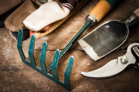 garden tool on grunge wood photo