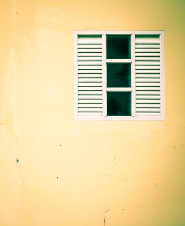 white window on grunge wall photo