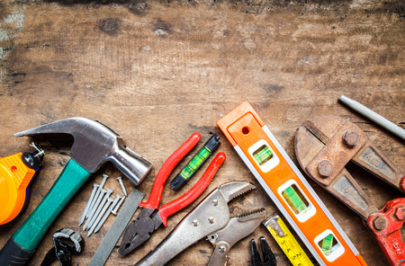 tool renovation on grunge wood photo