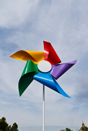 weathercock: colorful of  windmill in blue sky Stock Photo