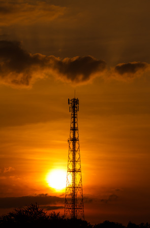 telecoms: pole telecoms with silhouette sunset Stock Photo