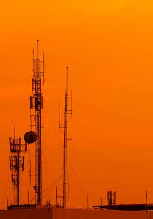 telecoms: silhouette pole telecoms with  sunset