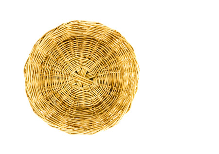 basket weaving: weaving wicker basket on isolated background