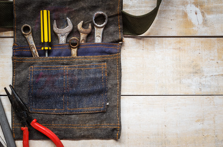 recreate: tool kit and jean bag on brown wood Stock Photo