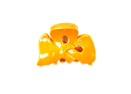 hair clip: yellow hair clip on isolated background Stock Photo