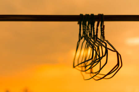 clothes rail: hanger on clothes rail with sunset background