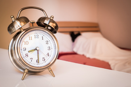 woman with clock: alarm clock with woman sleeping in bedroom