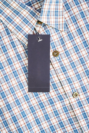 label tag: label paper tag price on shirt Stock Photo