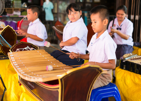 playing the market: Suphanburi Thailand-August 1,2015: students play Thai musical instruments at Sam Chuk market,old famous market in Sam Chuk district,Suphanburi,Thailand