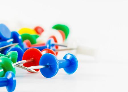 white pushpin: colorful pushpin on white background Stock Photo
