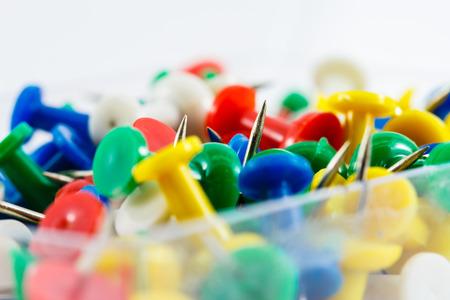 white pushpin: colorful pushpin inside glass box with white background