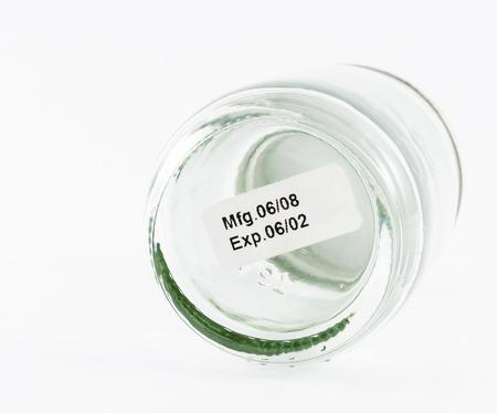expiration: label expiration on glass bottle