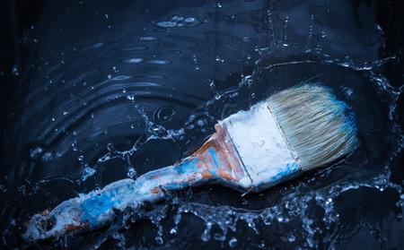 brush in: paint brush in water splash Stock Photo