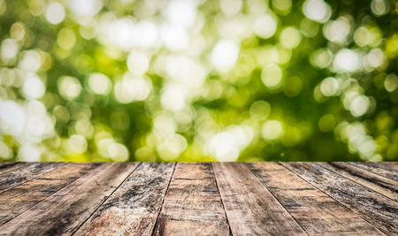 table top: wood table top with green nature background Stock Photo