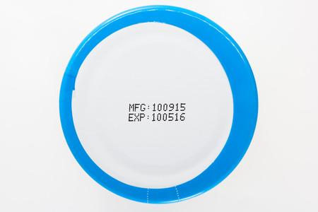 expiration: label expiration on bottle cap with white background