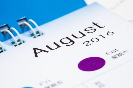 paper calendar with text august month