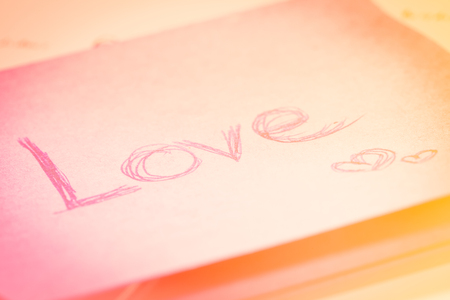 somebody: word love on paper note for somebody